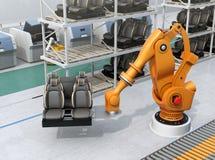 Bilsäten för robotic arm för tungvikt bärande i bilenhetsproduktionslinje Arkivbild