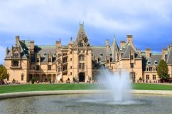 Biltmore Estate Mansion and reflecting pool, Asheville NC. Biltmore Estate is a large private estate and tourist attraction in Asheville, North Carolina. Built royalty free stock image