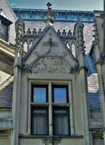 Biltmore House. Completed in 1895, a view of an ornate window during the rooftop tour of this American castle found in Asheville, North Carolina royalty free stock photo