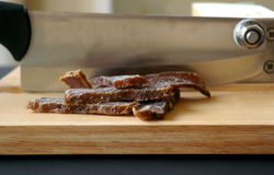 Biltong dried meat with slicer Stock Image