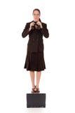 Binóculos da mulher de negócios Imagens de Stock