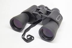 Binóculos pretos isolados no fundo claro Imagem de Stock Royalty Free