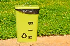 Bin. A green bin on flower background royalty free stock photo