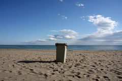 Bin on beach Royalty Free Stock Images