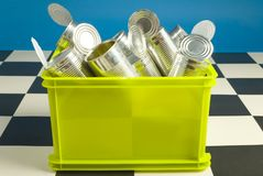 Bin full up with tins Stock Photography