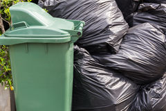 Bin and Garbage Bags Royalty Free Stock Photos