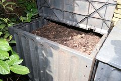 bin in the garden for Composting pile of rotting kitchen fruits and vegetable scraps stock photos