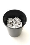 Bin half filled with paper. Bin half Filled with Trash royalty free stock photo