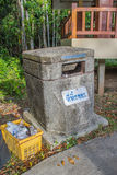 Bin made from cement with Thai wording mean garbage disposal her Royalty Free Stock Photo