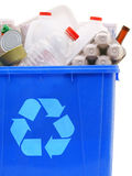 Bin of recyclables. A blue recycling bin full of recyclable things - bottles, containers, newspapers, cans Stock Photos