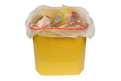Bin with trash (Garbage bin). Yellow trash can of garbage. Isolation on a white background. Clipping path stock photography