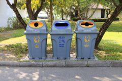 Bin, Trashcan, Plastic waste bin clear trash sideways walk at garden public, Plastic bin for waste recycle stock images