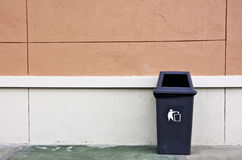 Bin and wall. Stock Photo
