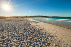 Binalong Bay. A bright sun illuminates a perfect white beach. Binalong Bay is situated at the southern end of the Bay of Fires and extends to Eddystone Point in Royalty Free Stock Photography