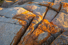 Binalong Bay. Closeup of red rocky in Binalong Bay, Bay of Fires consevation Area, east coast of Tasmania in Australia. Binalong Bay is just over 10 Kilometres Stock Photos