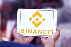 Binance cryptocurrency exchange logo. Logo of Binance exchange on samsung tablet. Binance is an international multi-language cryptocurrency exchange stock photography