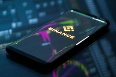 Binance wisząca ozdoba app na bieg na smartphone obraz royalty free