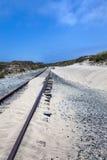 Binari ferroviari di Sandy fotografia stock