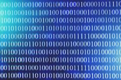 Binary code abstract background. Modern Technology internet communication and network data. Blue toned stock photos