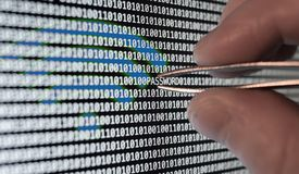 Binary Code. Wireless password vulnerability taking out with tweezers Royalty Free Stock Photography