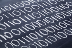 Binary code on blackboard Stock Photography