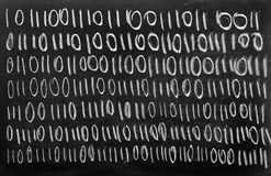 Binary code on blackboard Stock Images