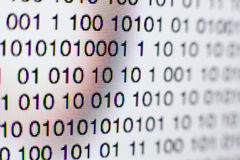 Binary code on a computer screen. Close-up of Binary code on a computer screen Stock Photo