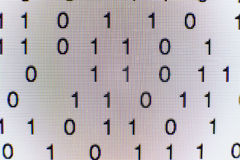 Binary code on a computer screen. Close-up of Binary code on a computer screen Stock Photos