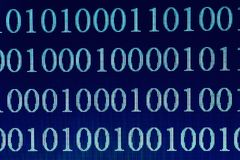 Binary Code on computer screen, macro shot. Technology internet background. Blue toned royalty free stock image