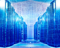 Binary code covers a portion of the mainframe in data center. Binary code covers a portion of the mainframe in the data center Stock Image