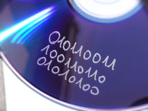 Binary code on data disc. Binary code handwritten on the surface of a data disc Royalty Free Stock Image
