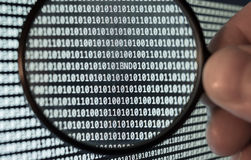 Binary Code. German BND on binary code, caught by magnifying glass Stock Photo