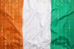 Binary code with Ivory Coast flag, data protection concept Stock Photography