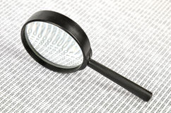 Binary code and magnifier Royalty Free Stock Images