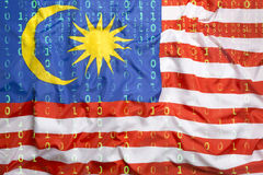 Binary code with Malaysia flag, data protection concept Royalty Free Stock Image
