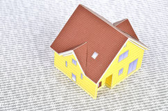Binary code and model house Stock Image