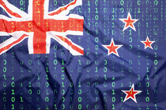 Binary code with New Zealand flag, data protection concept stock photos