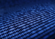 Binary code on pixellated screen Royalty Free Stock Images