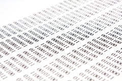 Binary code on white paper Stock Photos