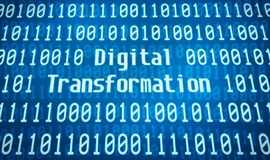 Digital Transformation. Binary code with the word Digital Transformation in the center royalty free stock photos