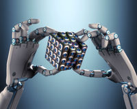 Binary Cube Logical Processing. Robot hand holding a binary cube concept of logical processing. Clipping path included Royalty Free Stock Image