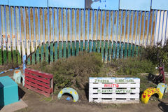 Binational garden at the border fence between Mexico and United Stock Image