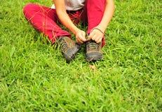 Bind uw schoenveters Stock Foto