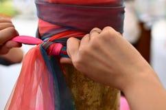 Binda in sju cubits för färgtyg sju länge Arkivbild