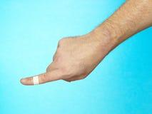 Bindemedel förbinder på fingerspets. Royaltyfri Bild