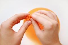 Bindende oranje ballon Royalty-vrije Stock Afbeeldingen