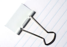 Binder Clip. Closeup of binder clip on lined paper Stock Photos