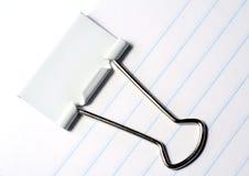 Binder Clip. Closeup of binder clip on lined paper stock photos