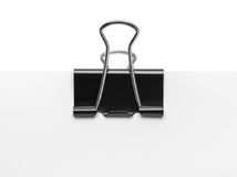 Binder Clip and Paper. Black Binder Clip on Paper Isolated on White Background Stock Photo