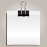 Binder clip and paper Royalty Free Stock Images